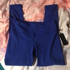 Bright blue ankle leggings with cutout detail